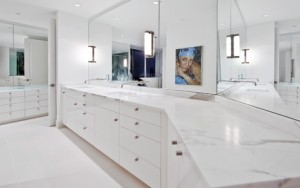 The modern master bathroom, at the Escala penthouse, done in high gloss white lacquer cabinetry, by Pedini